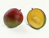 A mango beside a mango half