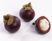 Two whole and one half mangosteen