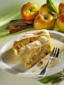 Two pieces of apple strudel with custard