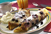 Two blueberry pancakes with cream