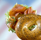 Poppy seed bagel filled with salmon