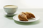 Milky coffee with a croissant
