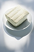 Block of tofu on a plate