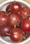 Red gooseberries in a small bowl