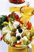 Vegetable salad with pieces of feta cheese and olives