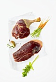Various goose pieces lying on greaseproof paper