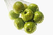 Granny Smith apples in green string bag