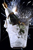 Sparkling wine still life: cooler, bottle & shower of sparks