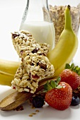 Muesli bar, fruit and carafe of milk