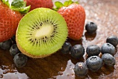 Half a kiwi fruit, blueberries and strawberries