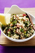 Pearl barley and parsley salad in a bowl