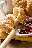 Croissant with jam for breakfast