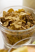 Mixed cereal flakes in a glass bowl