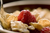 Flakes with raspberries, close-up