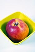 Peach in plastic bowl