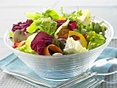Colourful mixed salad in a glass bowl