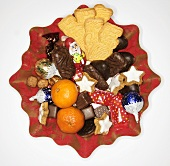 Biscuit plate with Christmas cookies and mandarin oranges