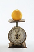 An Orange on a Metal Scale