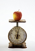 An Apple on a Metal Scale