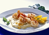 Shrimps in cocktail sauce with orange wedges