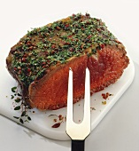 A piece of beef fillet with herb crust