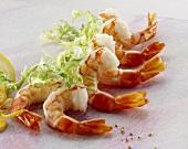 Several shrimp tails and frisée