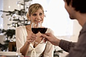 Young couple clinking glasses of red wine