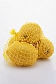 Four lemons in a net
