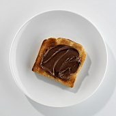 A slice of toast with Nutella on a plate