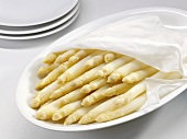 Cooked white asparagus on a platter