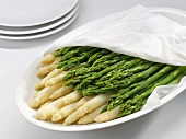 Cooked white and green asparagus on a platter