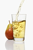 Pouring pear juice into a glass & pear