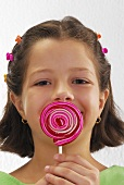 Small girl with lollipop