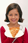 Small girl holding a slice of pizza on a plate