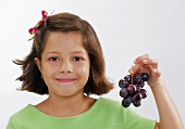 Small girl with grapes
