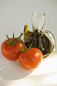 Fresh tomatoes and carafe of oil