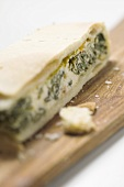 A piece of spinach, ricotta and pepper pie