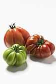 One green and two red beefsteak tomatoes