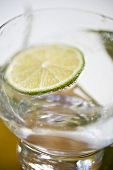 A glass of mineral water with slice of lime