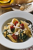 Rigatoni with spinach and cocktail tomatoes