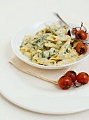 Pasta with spinach & ricotta sauce & baked cocktail tomatoes