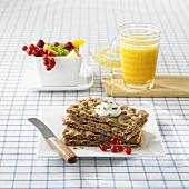 Breakfast of crispbread, fresh berries and orange juice