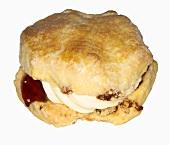 A scone with strawberry jam (England)