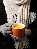 A cup of pumpkin soup