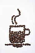 Shape of a cup of coffee in coffee beans
