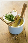 Bread and chives on a butter pot