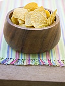 Tortilla chips in wooden bowl