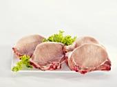 Four pork chops on a serving platter