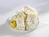 Four wedges of blue cheese on a plate