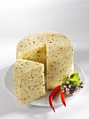 Tilsiter cheese with herbs and chilli